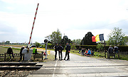 France, April 13th 2014: Gendarmes and spectators wait for the 2014 Paris Roubaix cyle race near a level crossing just before Pont Gibus, Wallers.