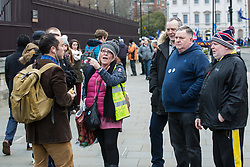 London, UK. 21st January, 2019. Supporters of Yellow Vests UK confront a Remainer outside the Houses of Parliament,