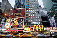 Aug 04, 2003; New York, NY, USA; Cabs and traffic along Broadway in Times Square. Billboards and electric message signs in plain view. Large two story McDonalds. Scenic view of New York City.  Stock photo. Graphic, Art.