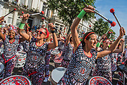 The Batala drum band from Brazil - The Monday of the Notting Hill Carnival. The annual event on the streets of the Royal Borough of Kensington and Chelsea, over the August bank holiday weekend. It is led by members of the British West Indian community, and attracts around one million people annually, making it one of the world's largest street festivals.