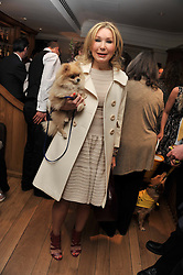 VALENTINA DROUIN and her dog Misha at The Dog's Trust Awards announcement held at George, 87-88 Mount Street, London on 27th March 2012.