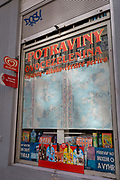 The window of a corner shop selling SIM cards, alcohol, cigarettes and fresh bakery products on Milady Horakove street, Holesovice district, Prague 7, on 20th March, 2018, in Prague, the Czech Republic.