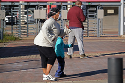 JOHANNESBURG, SOUTH AFRICA - MAY 10: A general view of a family exercising in Ellis Park during lockdown level 4 on May 10, 2020 in Johannesburg, South Africa. According to media reports, during lockdown level 4 people are allowed to exercise. Guidelines allow for cycling, running and walking as examples and must be within a 5km radius of their residences between 6:00 am – 9:00 am. (Photo by Dino Lloyd)