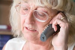 Woman using the telephone at work,