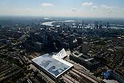 Nederland, Zuid-Holland, Rotterdam, 10-06-2015; dak, perron en sporen van het gerenoveerde en volkomen vernieuwde station van Rottterdam, Rotterdam CS. Achter het station het Groothandelsgebouw. Nieuwe Maas aan de horizon. Het spoorwegstation, bijnaam De Kapsalon is ontworpen door Benthem Crouwel Architekten.   <br /> The roof of the completely renovated railway station Rottterdam, Rotterdam Central (Benthem Crouwel architects) and is nicknamed The Hair Salon. <br /> luchtfoto (toeslag op standard tarieven);<br /> aerial photo (additional fee required);<br /> copyright foto/photo Siebe Swart