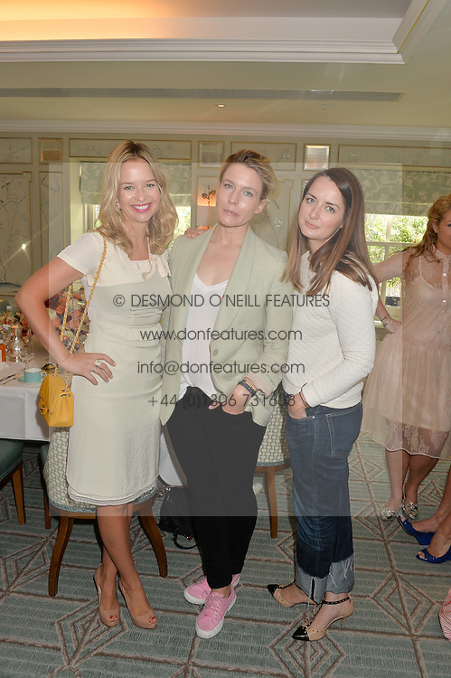 Left to right, MARISSA HERMER, CLARE GERAGHTY and AMY WILLIAMS at a breakfast hosted by Halcyon Days at Fortnum & Mason, 181 Piccadilly, London on 8th July 2014.