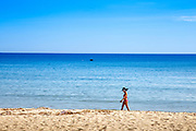 Blue Sky, Blue Water, woman in a red bikini on the beach at An Bang.