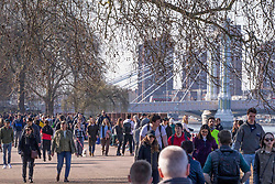 © Licensed to London News Pictures. 27/02/2021. London, UK. Members of the public enjoying sunny afternoon in Battersea Park, south London during the third national lockdown. Photo credit: Marcin Nowak/LNP