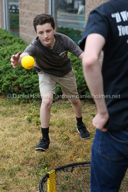 (6/23/18, NATICK, MA) Liam Beauregard, a sophomore at Natick High, left, and Danny Parker, a sophomore at Keefe Tech, play some Spike Ball at the Natick Outdoor Store on Saturday. [Daily News and Wicked Local Photo/Dan Holmes]