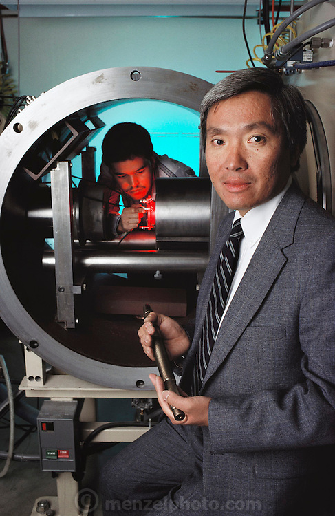 Los Alamos National Lab, New Mexico. Richard Mah seen with A3 Uranium Projectile research. The uranium projectile is very dense and is used for armor piercing weapons. MODEL RELEASED (1998)