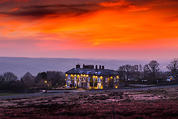 © Licensed to London News Pictures. 25/03/2020. Ilkley UK. The sky glows orange over the Cow & Calf pub high up on Ilkley Moor in Yorkshire at Dawn this morning on the second day of the Coronavirus lockdown. Photo credit: Andrew McCaren/LNP