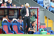 Mark Hughes, the Stoke City manager looks dejected as the match is almost over and his team are losing 4-0.  Premier League match, Crystal Palace v Stoke city at Selhurst Park in London on Sunday 18th Sept 2016. pic by John Patrick Fletcher, Andrew Orchard sports photography.