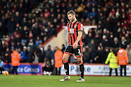 AFC Bournemouth Defender, Simon Francis (2) walks off after being sent off during the Premier League match between Bournemouth and Arsenal at the Vitality Stadium, Bournemouth, England on 3 January 2017. Photo by Adam Rivers.