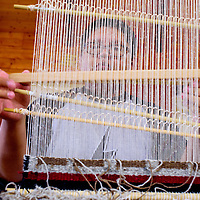 042815       Cable Hoover<br /> <br /> Ramus Brown runs a shuttle through his loom during a weaving class at Navajo Technical University in Crownpoint Tuesday.