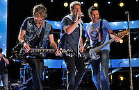 NASHVILLE, TN - JUNE 10:  Joe Done Rooney, Gary LeVox, and Jay DeMarcus of Rascal Flatts performs at LP Field during the 2012 CMA Music Festival on June 10, 2012 in Nashville, Tennessee.  (Photo by Frederick Breedon IV) Photo © Frederick Breedon. All rights reserved. Unauthorized duplication prohibited.