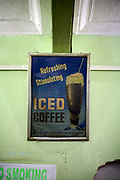Antique posters advertising coffee in the Indian Coffee House. Jaipur, India