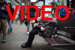 VIDEO AVAILABLE HERE: https://we.tl/4As1auVP06<br /> <br /> © Licensed to London News Pictures . 06/04/2017 . Manchester , UK . A man with a pipe in his hand lies slumped on a bench in front of Morrisons Supermarket in Piccadilly Gardens . An epidemic of abuse of the drug spice by some of Manchester's homeless population , in plain sight , is causing users to experience psychosis and a zombie-like state and is daily being witnessed in the Piccadilly Gardens area of Manchester , drawing large resource from paramedic services in the city centre . Photo credit : Joel Goodman/LNP