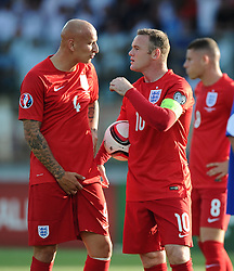Wayne Rooney of England (Manchester United) prepares to take a penalty while Jonjo Shelvey of England (Swansea City) adjusts himself  - Mandatory byline: Joe Meredith/JMP - 07966386802 - 05/09/2015 - FOOTBALL- INTERNATIONAL - San Marino Stadium - Serravalle - San Marino v England - UEFA EURO Qualifers Group Stage