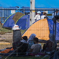 Illegal migrants take a rest in a refugee camp called Hangar near the border between Hungary and Serbia near Roszke (about 174 km South of capital city Budapest), Hungary on August 30, 2015. ATTILA VOLGYI