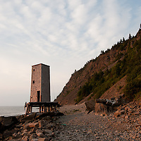 An old lookout at Dark Harbour on the west coast of Grand Manan Island, New Brunswick. The western shore of Grand Manan is mostly inaccessible except by boat. Dark Harbour is one of the few exceptions. Local legend has it that the best sea vegetables in the world come from the west side of Grand Manan, including around Dark Harbour. Incredible hikes abound in the area, both on the beach and on touring cliffs above. Look for small trail markers just above the beach for the cliff side trails. Photo by William Drumm.