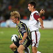 S.B. Elazigspor's player and Dirk Kuijt (L)  in action with ball during their Turkish superleague soccer match S.B. Elazigspor between Fenerbahce at the Ataturk stadium in izmir Turkey on Saturday 18 August 2012. Photo by TURKPIX