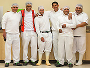 Happy workers at a cheese plant in Mexico during a break.
