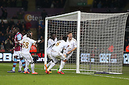 Federico Fernandez of Swansea city ® celebrates with his teammates after he scores his teams 1st goal. Barclays Premier league match, Swansea city v Aston Villa at the Liberty Stadium in Swansea, South Wales on Saturday 19th March 2016.<br /> pic by  Andrew Orchard, Andrew Orchard sports photography.