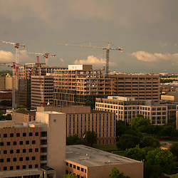 A cloud bank forms over construction of state office buildings north of the Texas Capitol in Austin while a spring weather system blows through central Texas. The mammatocumulus are characterized by cotton-like puffiness and dramatic formations.