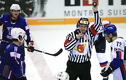 Anze Kopitar of Slovenia, Referee and Andrej Kollar of Slovakia at ice-hockey game Slovenia vs Slovakia at second game in  Relegation  Round (group G) of IIHF WC 2008 in Halifax, on May 10, 2008 in Metro Center, Halifax, Nova Scotia, Canada. Slovakia won after penalty shots 4:3.  (Photo by Vid Ponikvar / Sportal Images)