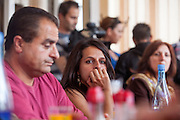"""Paralegal Romina Kajtazova during a meeting with the institutions about the topic: """"Patients Rights, advance health status and better health service of the Roma"""" in a restaurant in Delcevo, Macedonia."""