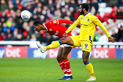 Dimitri Cavare of Barnsley heads clear of Stefan Payne of Bristol Rovers - Mandatory by-line: Robbie Stephenson/JMP - 27/10/2018 - FOOTBALL - Oakwell Stadium - Barnsley, England - Barnsley v Bristol Rovers - Sky Bet League One