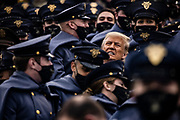WEST POINT, NY - DECEMBER 12: President Donald Trump is surrounded by Army Cadets in the stands during the 121st Army-Navy football game at Michie Stadium in West Point, NY on December 12, 2020.