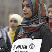 Young muslim woman wearing coloured hijab at public demonstration<br />