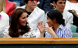 The Duchess of Cambridge and the Duchess of Sussex in the royal box on centre court on day twelve of the Wimbledon Championships at the All England Lawn Tennis and Croquet Club, Wimbledon. PRESS ASSOCIATION Photo. Picture date: Saturday July 14, 2018. See PA story TENNIS Wimbledon. Photo credit should read: Nic Bothma/PA Wire. RESTRICTIONS: Editorial use only. No commercial use without prior written consent of the AELTC. Still image use only - no moving images to emulate broadcast. No superimposing or removal of sponsor/ad logos. Call +44 (0)1158 447447 for further information.