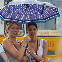 Women holds an umbrella during a rain shower in central Budapest, Hungary on May 03, 2013. ATTILA VOLGYI