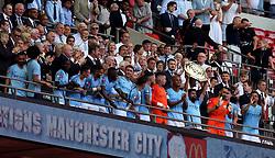 Manchester City'Äôs Sergio Aguero lifts up the Community Shield