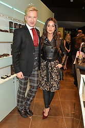 HENRY CONWAY and ROXIE NAFOUSI at a party in celebration of LCM 2015 and the launch of the Tateossian's first ever men's-only boutique at 55 Sloane Square, London on 10th January 2015.