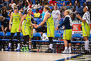 Aerial Powers of the Dallas Wings gets high fives from teammates after fouling out against the Connecticut Sun during a WNBA preseason game in Arlington, Texas on May 8, 2016.  (Cooper Neill for The New York Times)