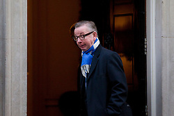 © Licensed to London News Pictures. 26/11/2013. London, UK. The Education Secretary, Michael Gove, pulls a face on the step of Number 10 Downing Street as he arrives for a meeting of British Prime Minister David Cameron's Cabinet in London today (26/11/2013). Photo credit: Matt Cetti-Roberts/LNP