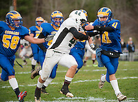 Kearsarge Cougar Peter Allen makes the tackle on Monadnock's running back Drew Bolewski during the NHIAA Division V semi final action.  (Karen Bobotas/for the Concord Monitor)