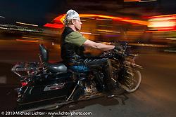 Cruising Main Street during Daytona Bike Week, FL, USA. March 9, 2014.  Photography ©2014 Michael Lichter.