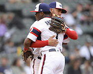 CHICAGO - SEPTEMBER 29:  Tim Anderson #7 of the Chicago White Sox is greeted by Danny Mendick #20 while leaving the game against the Detroit Tigers after clinching the American League batting title on September 29, 2019 at Guaranteed Rate Field in Chicago, Illinois.  (Photo by Ron Vesely)  Subject:   Tim Anderson; Danny Mendick