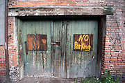 A hand painted 'No Parking' sign on old wooden doors in an old brick building. Missoula Photographer, Missoula Photographers, Montana Pictures, Montana Photos, Photos of Montana