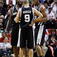 17 January 2012: San Antonio Spurs forward DeJuan Blair (45), San Antonio Spurs small forward Kawhi Leonard (2) listen to San Antonio Spurs point guard Tony Parker (9) during the Miami Heat 120-98 victory over the San Antonio Spurs at the AmericanAirlines Arena, Miami, Florida, USA.