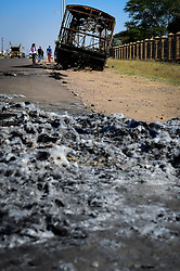 HAMMANSKRAAL, May 24, 2016 (Xinhua) -- The wreck of a burnt bus is seen in Hammanskraal, north of Pretoria, South Africa, on May 24, 2016. At least two people have been killed and six others injured during a violent protest in Hammanskraal, north of Pretoria, police said on Monday. The protest erupted on Monday when authorities tried to remove shacks that had been illegally built on a piece of land near a shopping mall, Pretoria Metro Police said. (Xinhua/Zhai Jianlan) (djj) (Credit Image: © Zhai Jianlan/Xinhua via ZUMA Wire)
