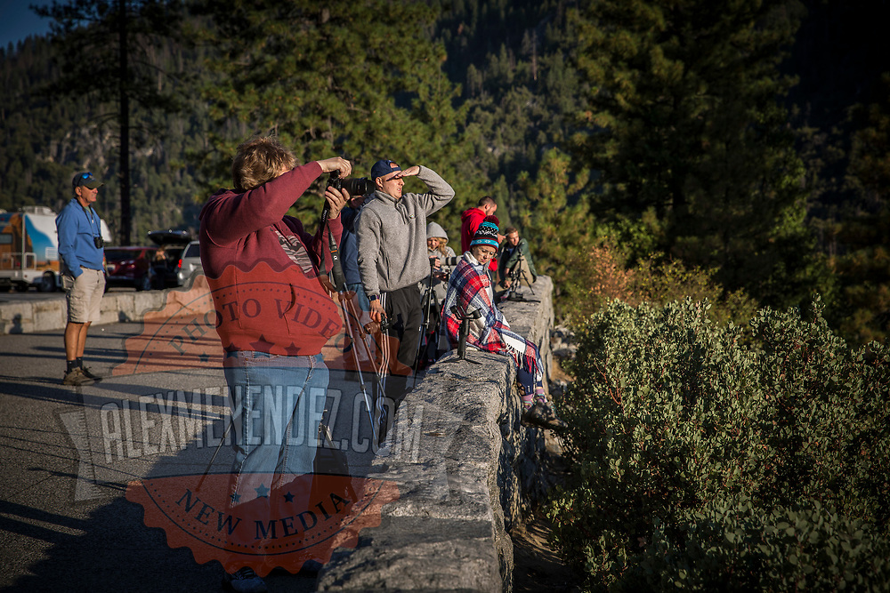 Photographers and visitors watch the sunrise at Tunnel View inside Yosemite National Park on Sunday, September 22, 2019 in Yosemite, California. (Alex Menendez via AP)
