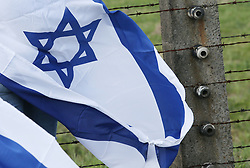 May 2, 2019 - Oswiecim, Poland - Participants of the March seen with the flags of Israel. The annual march is part of the educational program. Jewish students from all over the world come to Poland and study the remains of the Holocaust. Participants march in silence, three kilometers from Auschwitz I to Auschwitz II Birkenau, the largest Nazi complex of concentration camps built during World War II. (Credit Image: © Damian Klamka/SOPA Images via ZUMA Wire)