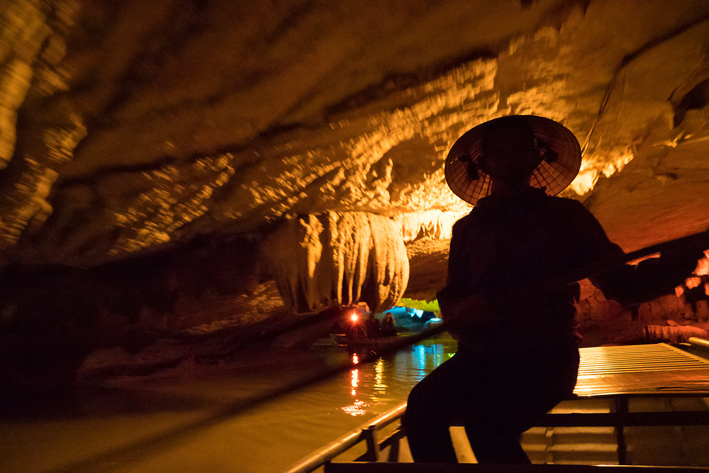 Asia, Vietnam, Son Ha, Thien Ha Galaxy Grotto cave. Tour guide rowing boat.