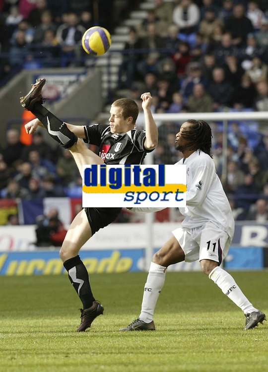 Photo: Aidan Ellis.<br /> Bolton Wanderers v Fulham. The Barclays Premiership. 11/02/2007.<br /> Fulham's Heidar Helguson clears the ball from Bolton's Ricardo Gardener