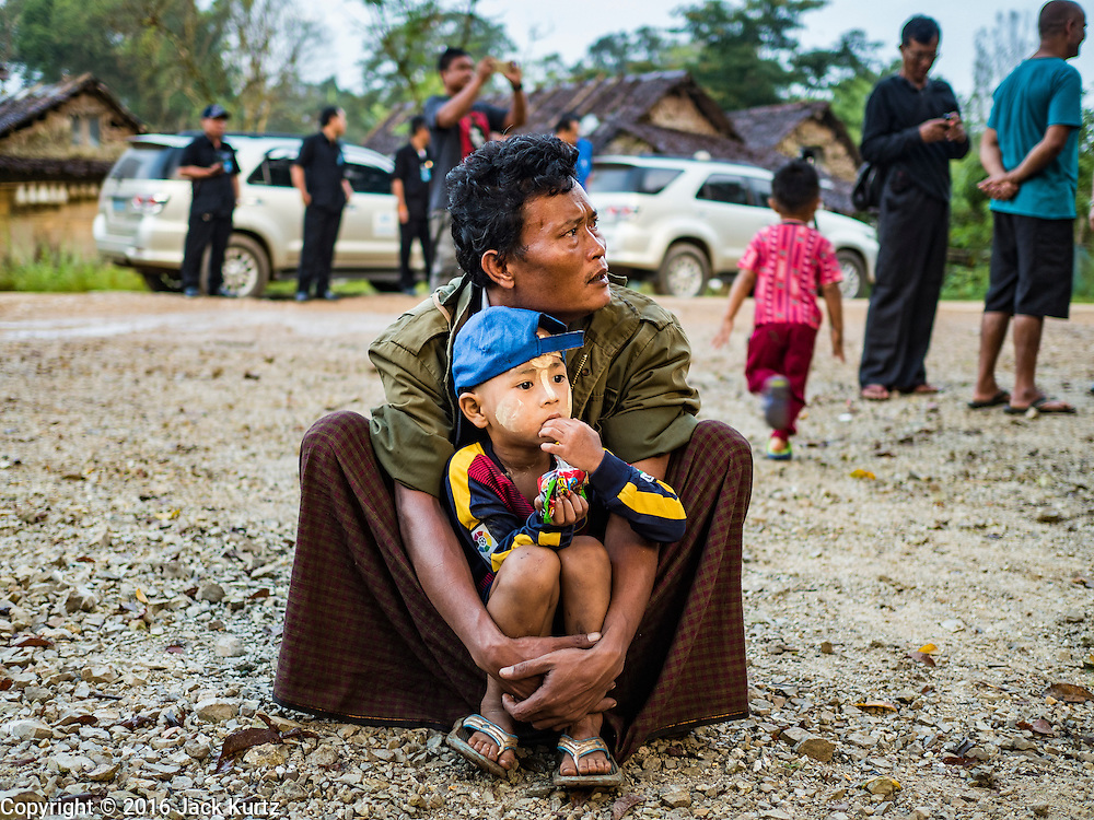 26 OCTOBER 2016 - NUPO TEMPORARY SHELTER, MAE CHAN, TAK, THAILAND: A Burmese man and his son in the Nupo Temporary Shelter refugee camp wait to be repatriated to Myanmar. Sixtyfive Burmese refugees living in the Nupo Temporary Shelter refugee camp in Tak Province of Thailand were voluntarily repatriated to Myanmar. About 11,000 people live in the camp. The repatriation was the first large scale repatriation of Myanmar refugees living in Thailand. Government officials on both sides of the Thai / Myanmar border said the repatriation was made possible by recent democratic reforms in Myanmar. There are approximately 150,000 Burmese refugees living in camps along the Thai / Myanmar border. The Thai government has expressed interest several times in the last two years in starting the process of repatriating the refugees.     PHOTO BY JACK KURTZ